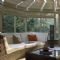 Triangular Woven Wood blinds to ceiling of wooden conservatory