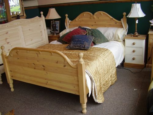 Carved bed. Contemporary coffee table. dark TV stand. Country Girl  Interior. Bespoke Solid Wood Kitchens & Bedrooms