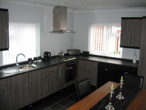 Leedscityinteriors kitchen designer in leeds uk Grey and black kitchens