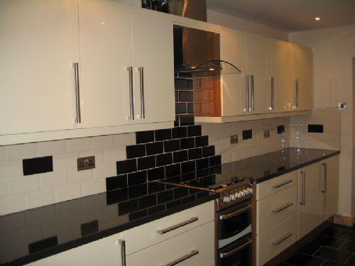 Leedscityinteriors kitchen designer in leeds uk for Cream black kitchen designs