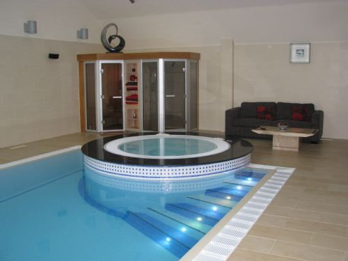 Indoor deck level swimming pool installation. - Swimming Pool Construction Companies Warrington