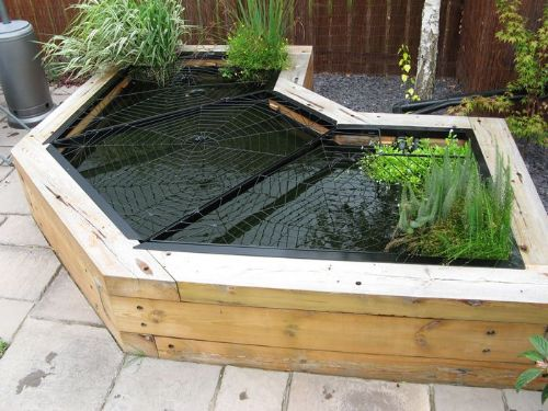 Elite pond covers metal fabrication company in for Decorative fish pond covers