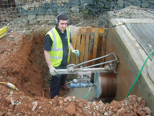 A 500mm hole cored through a reinforced sewage tank. - Drilling Companies Belfast