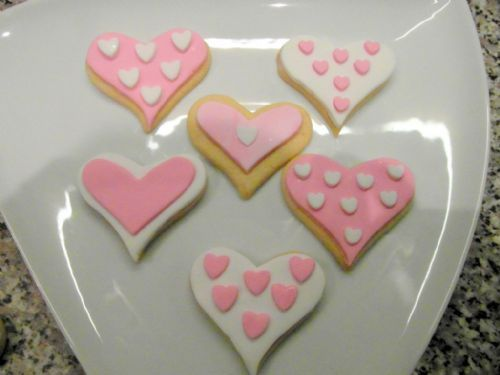Vanilla heart shaped biscuits decorated with fondant icing - Occasion Cake Makers Chessington