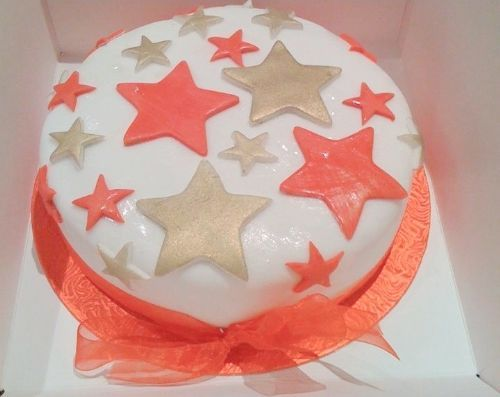 Christmas cake decorated with fondant icing star design - Occasion Cake Makers Chessington