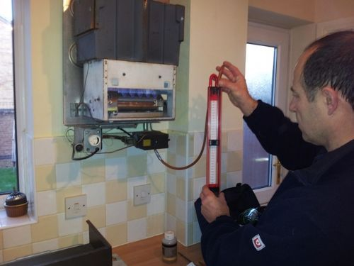 Servicing and testing a boiler. - Gas Fitters Bristol