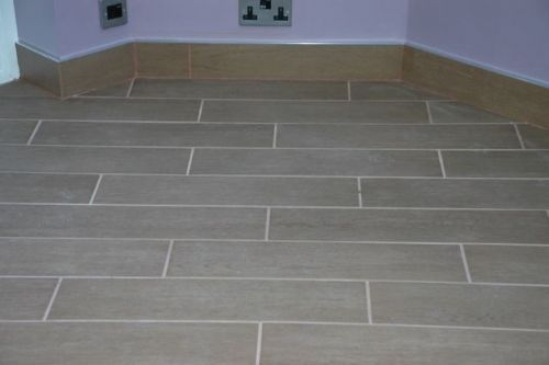 Grout And Under Tile Heating Tiled Skirting With Chrome Trim Edge