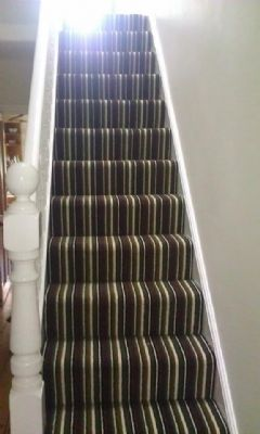 Stunning striped carpet on a staircase