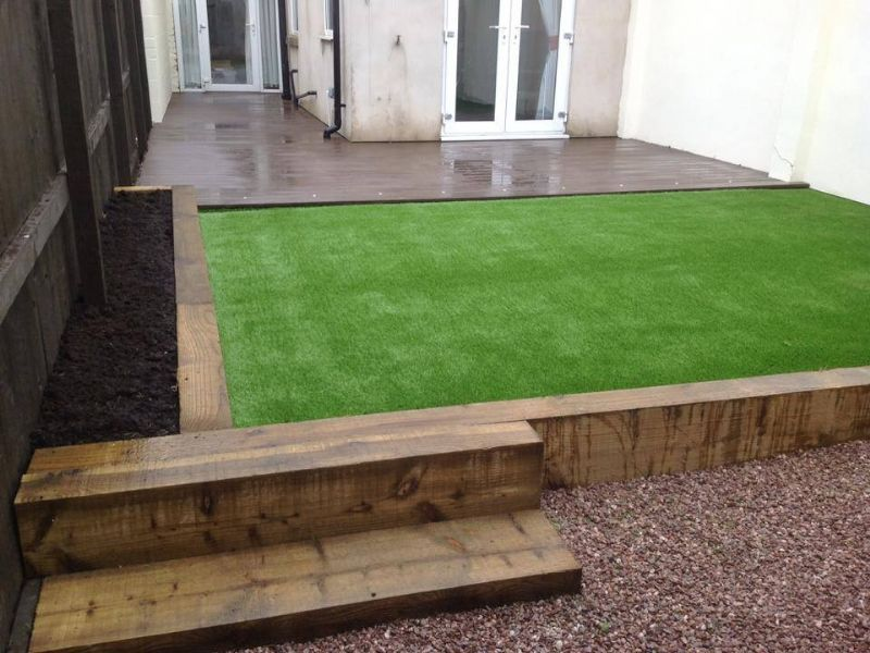 Lawn land artificial grass artificial grass supplier in for Garden decking and grass