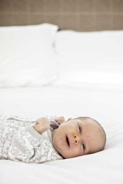 Amy specialises in beautiful candid portraits of newborns